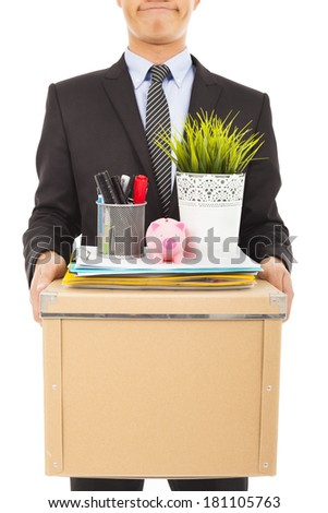 fired businessman felling sad and carrying his belongings - stock photo