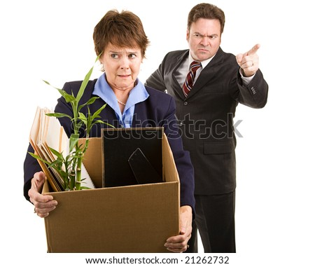 Fired corporate employee holding her belongings in a cardboard box, as her boss orders her out of the building.  Isolated on white. - stock photo
