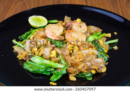 Fired noodle with shrimps,shrimped focus. - stock photo
