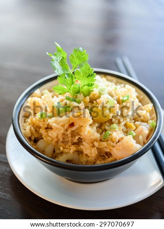 Fired Rice Chinese Style on Back Bowl with Chopsticks. - stock photo