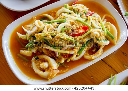 Fired squid with salty egg (Thai food) - stock photo
