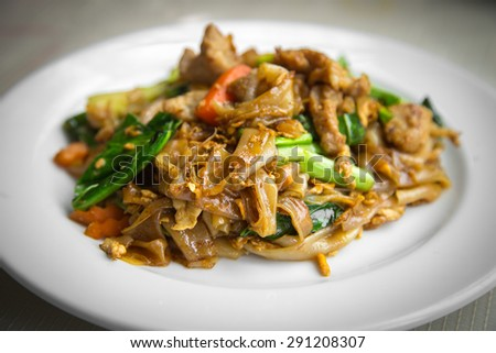 Fired thin noodles with soy sauce ,Thai food - stock photo