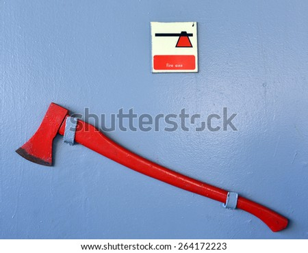 Firefighter axe on the cruiser boat wall - stock photo