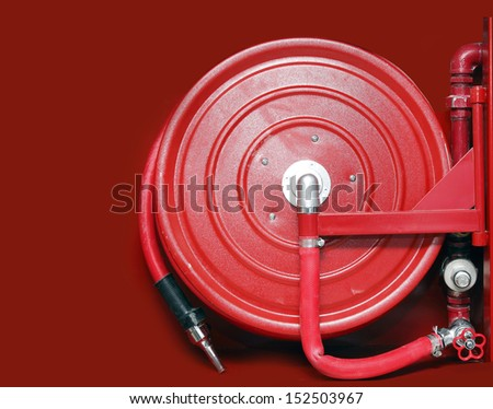 firefighter hose on the red background - stock photo