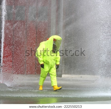 Firefighter protective yellow jumpsuit with for protection from radiation and chemical agents - stock photo