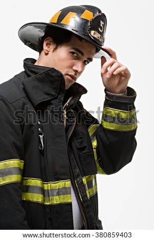 Firefighter tipping his hat - stock photo