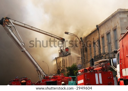 Firefighters at the fire in the  citycenter - stock photo