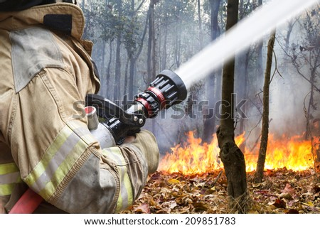 firefighters helped battle a wildfire - stock photo