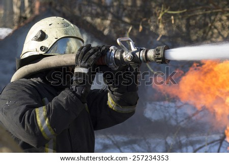 Firefighters in action - stock photo