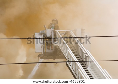 firefighters in smoke - stock photo