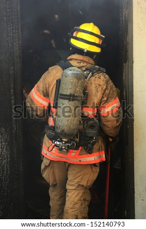 Firefighters respond to a structure fire in a residence that caused major interior damage.  No body was injured  - stock photo