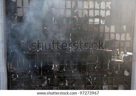 Firefighters Tackle a Blaze at an Office Block - stock photo