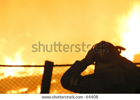 fireman and blaze - stock photo