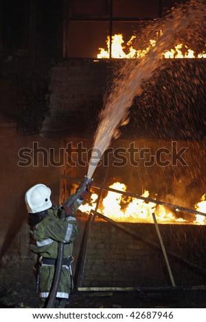 Fireman fighting a fire - stock photo