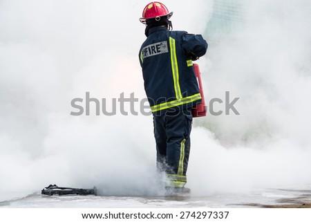 fireman fighting fire - stock photo