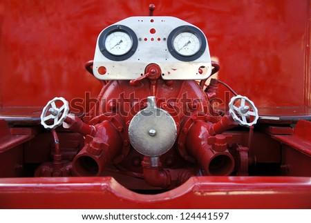 Fireman fire truck hose faucets - stock photo