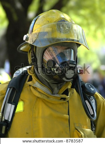 Fireman in protective gear. - stock photo