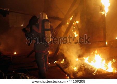 Fireman with accident victim - stock photo