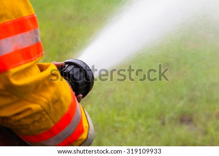 Fireman work Fire sprinklers. - stock photo