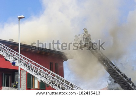 Firemans at work - stock photo