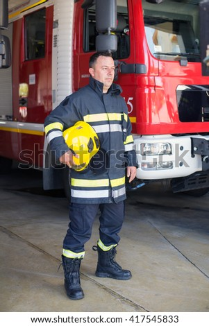 Firemans on duty,under exposed photo - stock photo