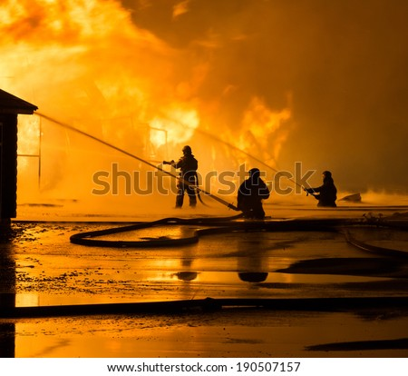 Firemen at work on fire - stock photo