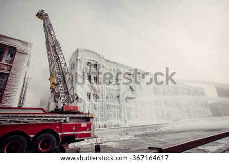 Firemen in action - stock photo
