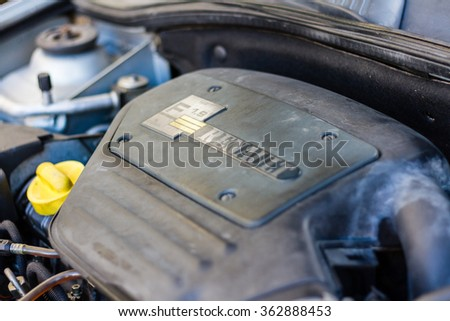 Firenze, Italy - January 15th, 2016: Renault logo plate on the engine of a car. Renault is a famous European automotive manufacturer based in France. Selective focus on the logo. - stock photo