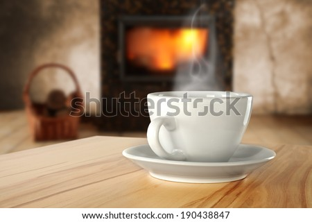 fireplace and cup of warm drink  - stock photo