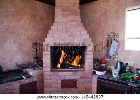 fireplace on a summer kitchen. remarkable construction for rest and for cooking. - stock photo