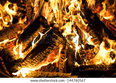 Fireplace with a blazing fire, dramatic view of the flames.  - stock photo