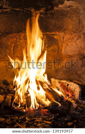 Fireplace with a blazing fire, relaxing view of the fire. - stock photo