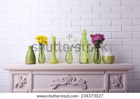 Fireplace with beautiful decorations in room  - stock photo
