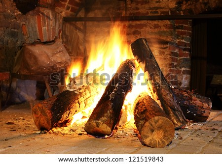 Fireplace with firewoood inside - stock photo