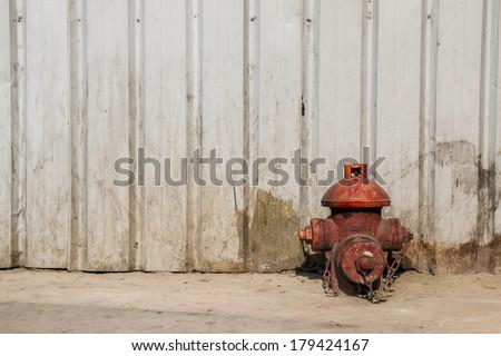Fireplug on dirt ground - stock photo