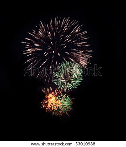 Fires of celebratory salute against the black sky - stock photo
