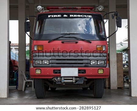 firetruck parking in firehouse - stock photo
