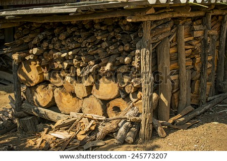 Firewood logs / Firewood in a pile mountain village ,Thailand - stock photo