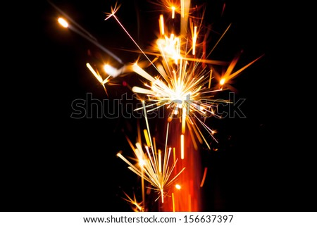 firework sparkler, close-up view - stock photo