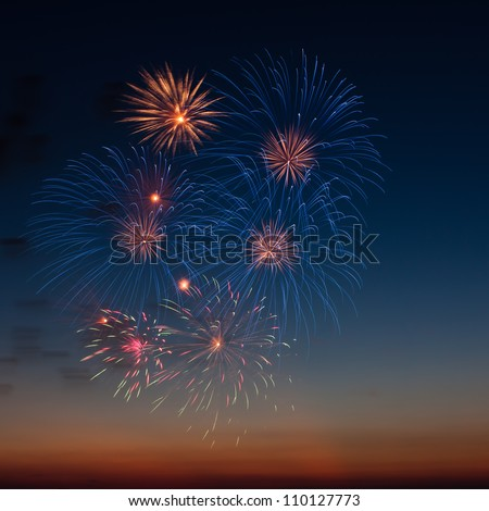 Firework with a beautiful colored background - stock photo