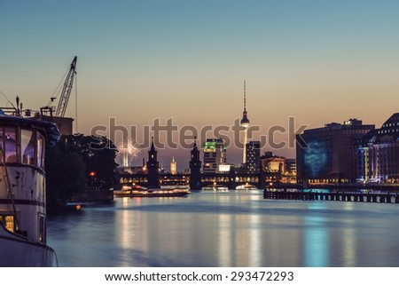 Fireworks above Berlin Skyline, TV Tower, Oberbaumbruecke and Spree River at evening, Germany, Europe, vintage filtered style - stock photo