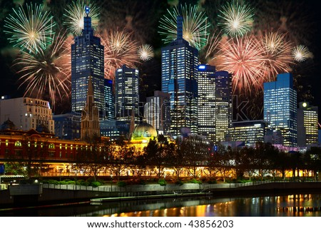 Fireworks and night illumination in center of Melbourne city - stock photo