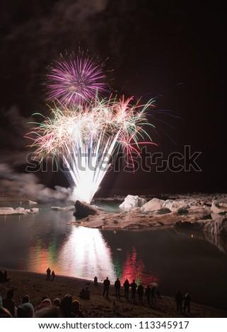 Fireworks at Jokulsarlon for ending summertime - stock photo