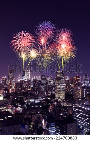 Fireworks celebrating over Tokyo cityscape at night of Japan - stock photo