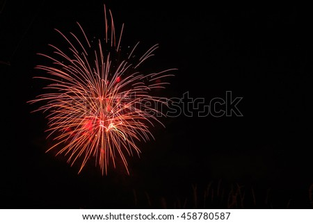 Fireworks in dark night sky with copy space. - stock photo