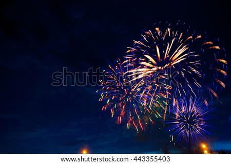 Fireworks in sky twilight. Fireworks display on dark sky background. Independence Day, 4th of July, Fourth of July or New Year. - stock photo