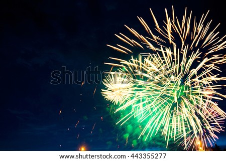 Fireworks light up the sky with dazzling display. Fireworks display on dark sky background. Independence Day, 4th of July, Fourth of July or New Year. - stock photo