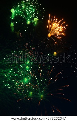 fireworks of various colors over night sky - stock photo