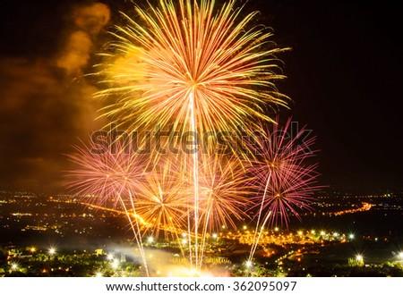 Fireworks on night city background - stock photo