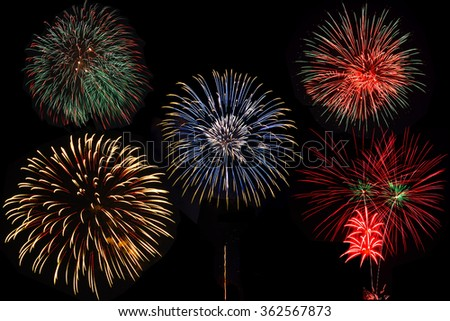 Fireworks on night sky background. - stock photo